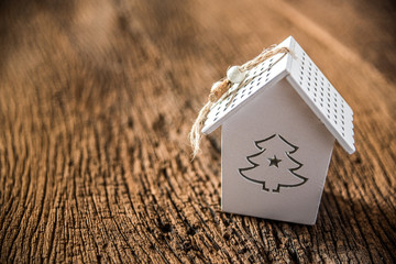 white christmas tree house on grnage wooden background
