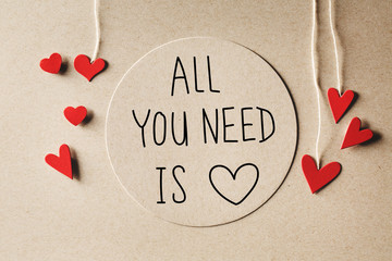 All You Need Is Love message with handmade small paper hearts