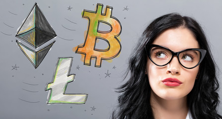 Bitcoin, Ethereum and Litecoin with young businesswoman in a thoughtful face