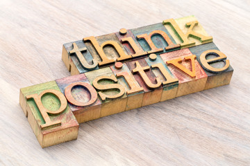 Think positive word abstract in wood type