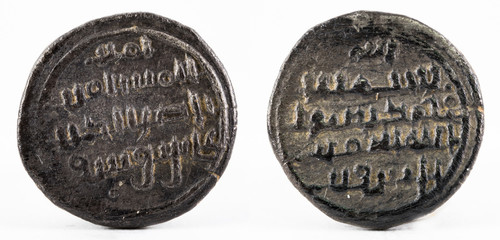 Ancient medieval silver quirat coin of Almoravids. Minted in the ancient Al-Andalus at present Spain.