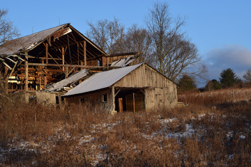 Collapsing Barn in a Snow Covered Field