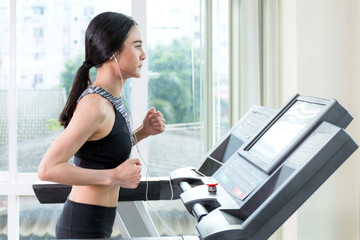 Woman exercise by running machine..