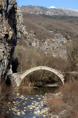 Amazing landscape of Bridge of Kontodimos or Lazaridis in Vikos gorge and Pindus Mountains, Zagori, Epirus, Greece