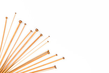 Wooden bamboo knitting needles on white background