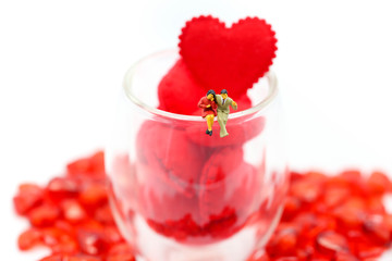 Miniature people: Couple and valentine decorations character with copy space using as background valentine day, Love couple concept