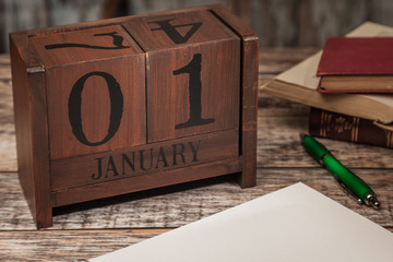 Perpetual Calendar in desk scene with blank diary page, January 1st