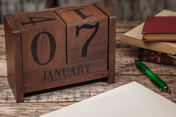 Perpetual Calendar in desk scene with blank diary page, January 7th