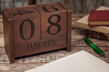 Perpetual Calendar in desk scene with blank diary page, January 8th