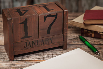 Perpetual Calendar in desk scene with blank diary page, January 17th