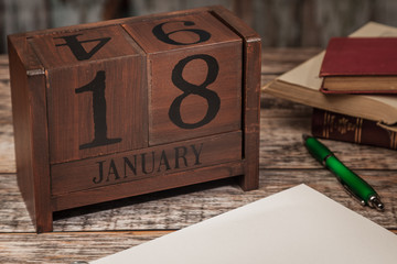 Perpetual Calendar in desk scene with blank diary page, January 18th