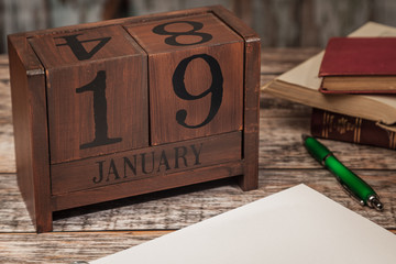 Perpetual Calendar in desk scene with blank diary page, January 19th