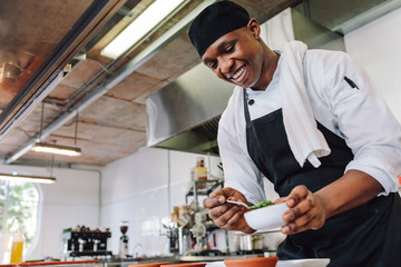 Gourmet chef cooking in a commercial kitchen