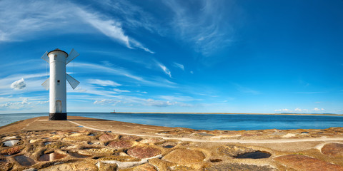 Fototapeten Leuchtturm Panoramic image of an old lighthouse in Swinoujscie, a port in Poland on the Baltic Sea