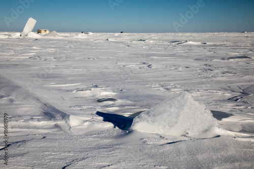 Lifted ice chunks in the snow - ice fishing on Lake of the