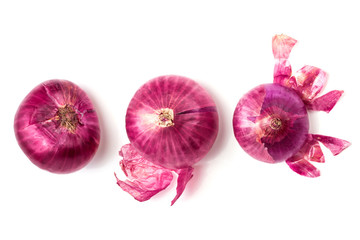 The Fresh red onion bulb and onion peel isolated on white background