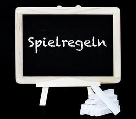 Spielregeln Text auf einer Tafel