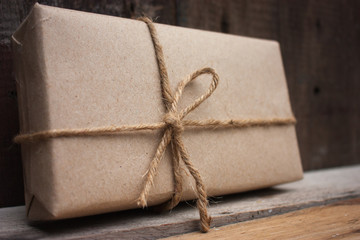 gift box on brown wood background