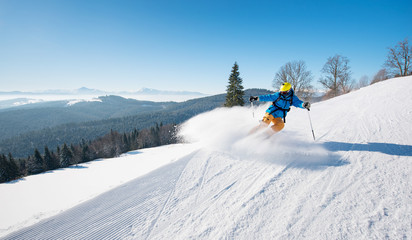 Professional skier riding the slope on a beautiful winter day ski resort recreation travelling tourism vacation extreme adrenaline