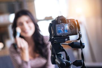 Makeup tutorial video. Selective focus of professional camera recording a makeup tutorial video