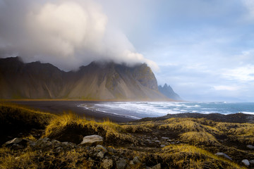 The rugged Vestrahorn mountains at Hofn, Iceland, viewed from the black sand beach at Stokksnes.