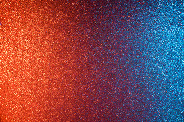 Red and blue abstract glitter background, shiny blurred bokeh on corners and sharp in center