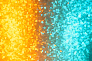 Colorful festive orange and cyan festive lights defocused bokeh abstract background