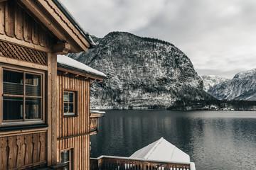Wooden house at mountain lake, Hallstatt, Austria.