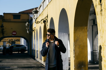 Handsome man walking on street