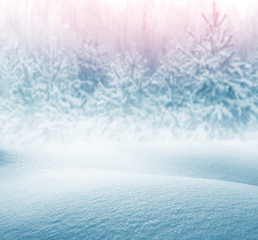 Winter background for design with snowdrifts and the snow-covered wood