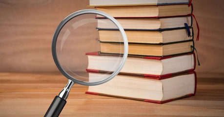 3D Magnifying glass over books