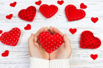 Female hands giving red heart. Valentine day background