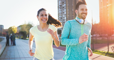 Couple jogging outdoors Wall mural