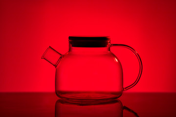 Teapot on red background.Graphics images.