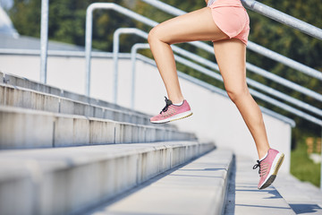 Close-up of woman running on stairs