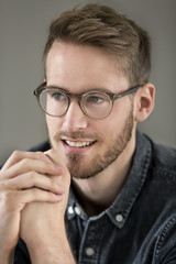Portrait of smiling young man with glasses