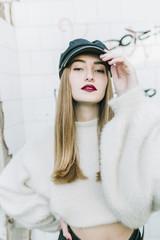 Stylish model posing on grungy background