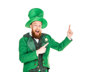 excited handsome leprechaun in green suit and hat presenting something, isolated on white Wall mural