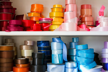 Rolls of colored ribbons for flowers.