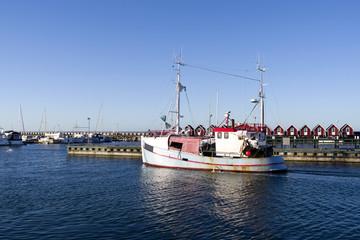 Laesoe / Denmark: A fishing cutter leaves the harbor of Vesteroe Havn