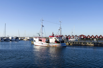 Laesoe / Denmark: A fishing cutter leaves the harbor of Vesteroe Havn