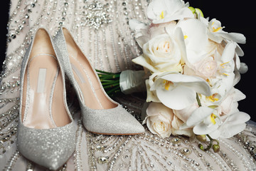 Luxury ivory shoes and bride jewel on the table