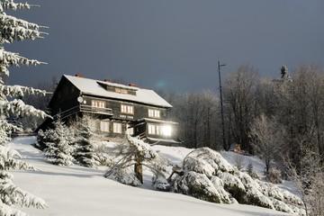 Hut hidden in the woods in snow during winter. Slovakia