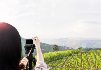 Women shooting photo or video of landscape sky and mountain nature view