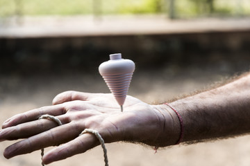 Spinning top on hand - traditional toy in Rajkot, Gujarat, India