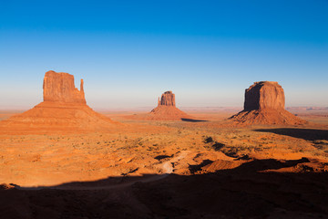 The famous Buttes of Monument Valley, Utah, USA during sunset on a clear autumn afternoon