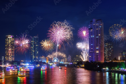 firework downtown happy new year in bangkok city thailand view form taksin bridge with chaopraya