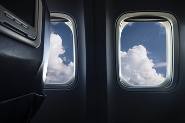 Clouds behind airplane window