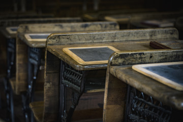 Old wooden desks in classroom, Georgia, USA