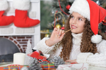 little girl preparing for Christmas
